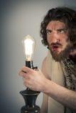 Ηλίθιο Caveman Lightbulb Στοκ Εικόνα