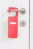 Η λαβή μιας πόρτας με το α δεν ενοχλεί την ετικέτα σε το Στοκ φωτογραφία με δικαίωμα ελεύθερης χρήσης