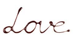 Η αγάπη λέξης που γράφεται από την υγρή σοκολάτα στο λευκό Στοκ φωτογραφίες με δικαίωμα ελεύθερης χρήσης