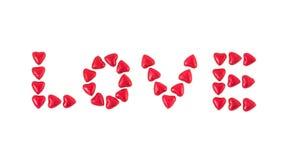 Η αγάπη λέξης που γράφεται με τις καρδιές Στοκ Εικόνα