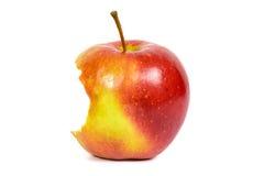 Η δαγκωμένη κόκκινη Apple στο άσπρο υπόβαθρο Στοκ Φωτογραφία