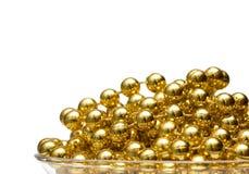 η ανασκόπηση διακοσμεί το χρυσό με χάντρες Στοκ φωτογραφία με δικαίωμα ελεύθερης χρήσης