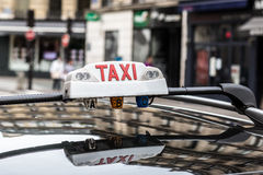 η ανασκόπηση είναι όπως μπορεί να υπογράψει τη χρήση ταξί Στοκ Εικόνα