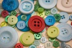 η ανασκόπηση κουμπώνει διαφορετικός πολλοί το ράψιμο Στοκ Φωτογραφία