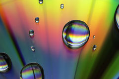 η ανασκόπηση ρίχνει το πολύχρωμο ύδωρ Στοκ εικόνα με δικαίωμα ελεύθερης χρήσης