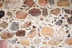 η ανασκόπηση χρωματίζει grunge τον τοίχο πετρών Στοκ Φωτογραφία