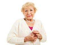 Αρθρίτιδα - δυσκολία με τα κουμπιά στοκ εικόνες με δικαίωμα ελεύθερης χρήσης