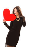Η αποτελεσματική νέα γυναίκα σε ένα μαύρο φόρεμα Στοκ Εικόνες