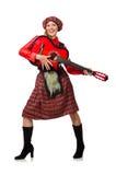 Η αστεία γυναίκα στο σκωτσέζικο ιματισμό με την κιθάρα Στοκ Φωτογραφίες