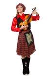 Η αστεία γυναίκα στο σκωτσέζικο ιματισμό με το βιολί Στοκ Εικόνες