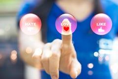 Η αφηρημένη γυναίκα που πιέζει τα σύγχρονα ζωηρόχρωμα κουμπιά συγκίνησης, αγαπά ομο Στοκ φωτογραφίες με δικαίωμα ελεύθερης χρήσης
