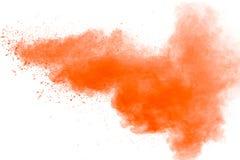 η αφηρημένη πορτοκαλιά σκόνη στο άσπρο υπόβαθρο Στοκ φωτογραφία με δικαίωμα ελεύθερης χρήσης