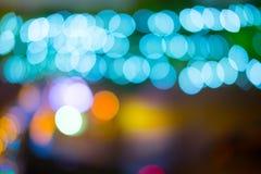 Η αφηρημένη πόλη υποβάθρου ανάβει τη νύχτα Στοκ Εικόνες