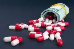 Η βιομηχανία φαρμάκων παίρνει υψηλή στα παχιά κέρδη στοκ φωτογραφίες