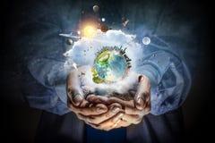 η γη δίνει τον πλανήτη μας Μικτά μέσα Στοκ Εικόνα