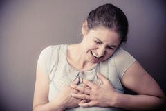 Η γυναίκα αισθάνεται τον πόνο πόνου Στοκ Εικόνες