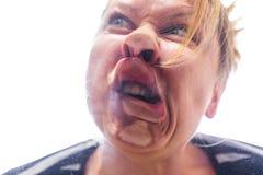 Η γυναίκα αντιτίθεται ένα πλακάκι στοκ φωτογραφία με δικαίωμα ελεύθερης χρήσης