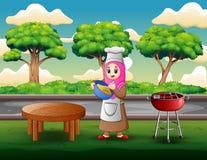 Η γυναίκα κάνει τη ζύμη και το μαγείρεμα υπαίθρια απεικόνιση αποθεμάτων