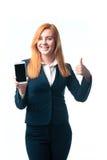 Η γυναίκα καταδεικνύει ένα τηλέφωνο Στοκ Φωτογραφία