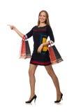 Η γυναίκα με τις τσάντες αγορών που απομονώνεται στο λευκό Στοκ Εικόνα