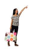 Η γυναίκα με τις τσάντες αγορών που απομονώνεται στο λευκό Στοκ Εικόνες
