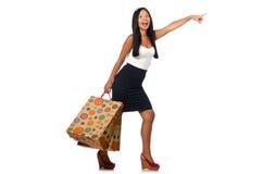 Η γυναίκα με τις τσάντες αγορών στο λευκό Στοκ φωτογραφία με δικαίωμα ελεύθερης χρήσης