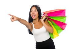 Η γυναίκα με τις τσάντες αγορών στο λευκό Στοκ εικόνα με δικαίωμα ελεύθερης χρήσης