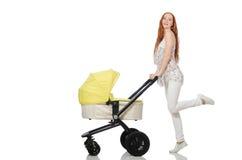 Η γυναίκα με το μωρό και καροτσάκι που απομονώνεται στο λευκό Στοκ εικόνα με δικαίωμα ελεύθερης χρήσης