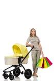 Η γυναίκα με το μωρό και καροτσάκι στο λευκό στοκ φωτογραφίες με δικαίωμα ελεύθερης χρήσης