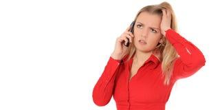 Η γυναίκα παίρνει τις κακές ειδήσεις κατά τη διάρκεια του τηλεφωνήματος Στοκ Φωτογραφία