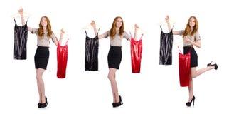 Η γυναίκα που επιλέγει το φόρεμα που απομονώνεται στο λευκό Στοκ φωτογραφίες με δικαίωμα ελεύθερης χρήσης