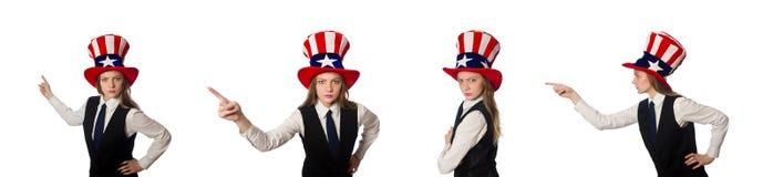 Η γυναίκα που φορά το καπέλο με τα αμερικανικά σύμβολα στοκ εικόνα