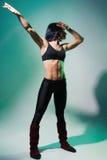 Η γυναίκα συμμετέχει στη γυμναστική Στοκ Εικόνα