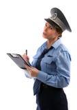 Η γυναικεία σπόλα γράφει ένα εισιτήριο στοκ φωτογραφίες