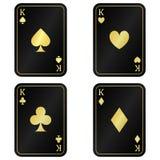 Η διασκέδαση έθεσε σε τέσσερα το μαύρο βασιλιά καρτών με το χρυσό στοκ φωτογραφία με δικαίωμα ελεύθερης χρήσης