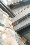 Η δομή γωνιών του σπιτιού Σύσταση - τεχνητή διακοσμητική πέτρα façade γκρίζα σύσταση υποβάθρου τοίχων πετρών χρώματος τραχιά Στοκ Εικόνες