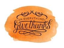 Η εγγραφή χεριών σε όλα δίνει τις ευχαριστίες στο υπόβαθρο watercolor στοκ εικόνες