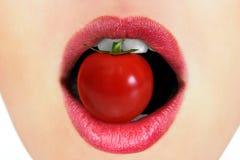 Χείλια με την ντομάτα Στοκ Εικόνες