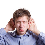 Η εκμετάλλευση ατόμων δίνει κοντά στα αυτιά, μορφασμός, κουτσομπολιό Στοκ Εικόνες
