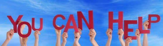 Η εκμετάλλευση το κόκκινο Word χεριών εσείς μπορεί να βοηθήσει το μπλε ουρανό Στοκ Εικόνες