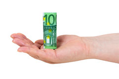 Η εκμετάλλευση χεριών κύλησε το ευρο- τραπεζογραμμάτιο 100 Στοκ Φωτογραφία