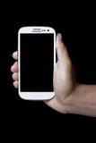 η εκμετάλλευση χεριών τραπεζών ανασκόπησης σημειώνει το smartphone Στοκ Εικόνες