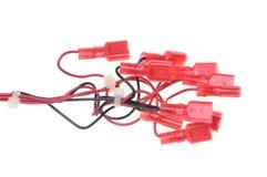 Ηλεκτρικά καλώδια με τα κόκκινα τερματικά Στοκ Εικόνες