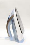 Ηλεκτρικός σίδηρος για το σιδέρωμα σε ένα ελαφρύ υπόβαθρο Στοκ Εικόνες