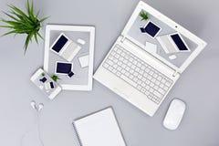 Ηλεκτρονικές συσκευές με τις απαντητικές εικόνες σχεδίου Ιστού στις οθόνες στοκ εικόνες με δικαίωμα ελεύθερης χρήσης