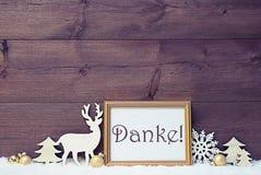 Η εκλεκτής ποιότητας άσπρη και χρυσή κάρτα Χριστουγέννων, χιόνι, Danke σημαίνει τις ευχαριστίες στοκ εικόνες με δικαίωμα ελεύθερης χρήσης