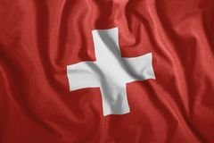 Η ελβετική σημαία κυματίζει στον αέρα Ζωηρόχρωμος, εθνική σημαία της Ελβετίας πατριωτισμός διανυσματική απεικόνιση