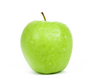 Η ενιαία πράσινη Apple που απομονώνεται σε μια άσπρη ανασκόπηση Στοκ Φωτογραφίες
