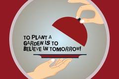 Η εννοιολογική παρουσίαση γραψίματος χεριών για να φυτεψει έναν κήπο πρόκειται να πιστεψει στο αύριο Ελπίδα στο μέλλον HU κινήτρο απεικόνιση αποθεμάτων