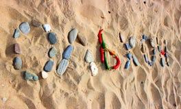 Η επιγραφή στην άμμο στα ρωσικά: Στοκ εικόνες με δικαίωμα ελεύθερης χρήσης